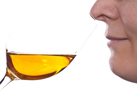 sauternes: Woman is smelling at the glas of a dessert wine