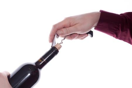 Eine Flasche Rotwein mit einem Korkenzieher öffnen Standard-Bild - 11727752