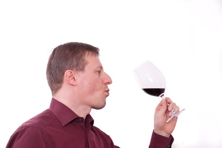 savour: A man is tasting a red wine