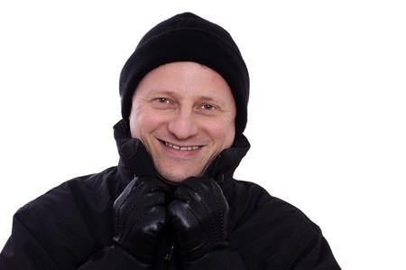 Anorak: Ein l�chelnder Mann mit Pudelm�tze und Lederhandschuhe