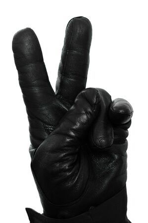 leather glove: A hand with a black leather glove is showing the victory sign Stock Photo