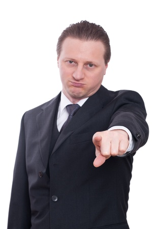 annoy: A man in a suit is pointing forward with his forefinger