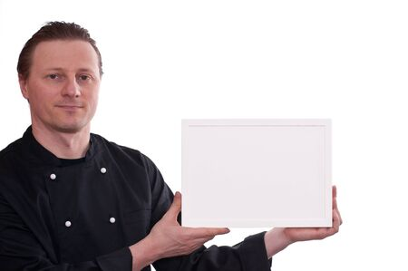 upholding: A man as cook is upholding a white frame
