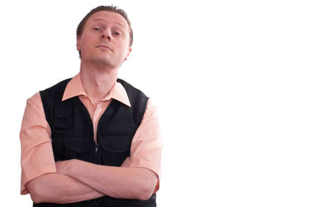 sceptical: A man with crossed arme is looking sniffy and sceptical Stock Photo