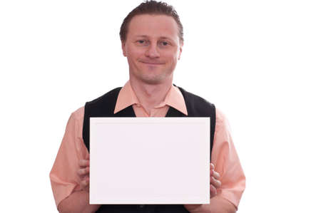 A smiling male photographer is holding a white blank picture frame with his hands Stock Photo