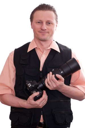 A smiling photographer with a single-lens reflex camera and a telephoto lens photo