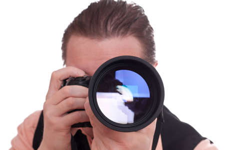 telephoto: Male photographer with a single-lens reflex camera and huge telephoto lens