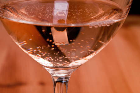 carbonic: Carbonic acid in a glass of rose wine