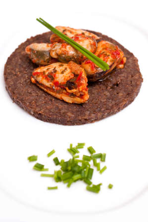 Canape with Pumpernickel and marinated mussels and chives Stock Photo - 12533973