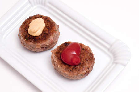 Two meatballs on a plate with mustard and ketchup Stock Photo - 12533979