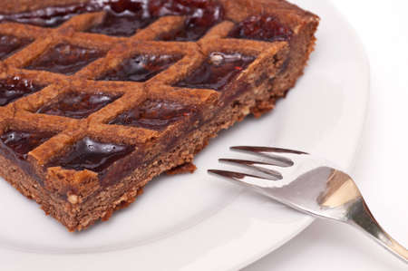 Linzer tarte with cake fork on a plate photo