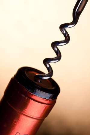 cork screw: A spindle of a cork screw in the cork of a wine bottle