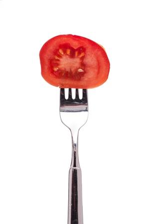 Weiß isolierten Rotbusch Tomate auf einer Gabel Standard-Bild - 12851138