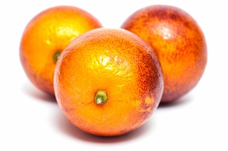 citrous: Three blood oranges in front of a white background Stock Photo