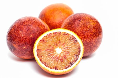 citrous: Four moro blood oranges and one is cut Stock Photo