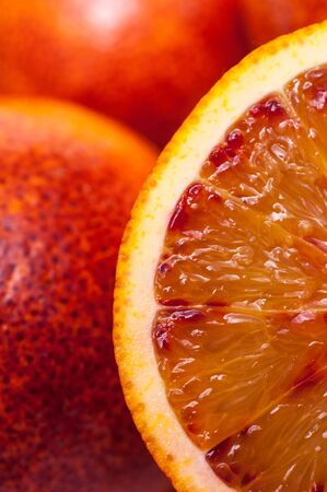 citrous: Close-up of a slice of a blood orange in vertical-format Stock Photo