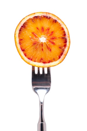 citrous: Fork with a sliced blood orange