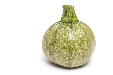Single round green courgette in front of a white background Stock Photo - 12957810