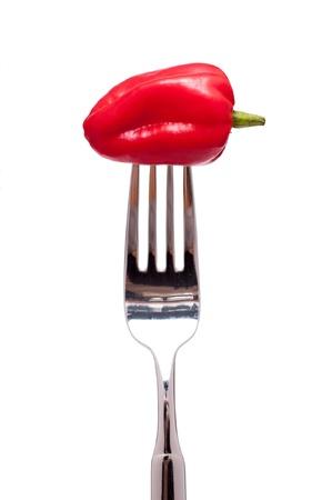 白い分離フォークの上の赤唐辛子ハバネロ 写真素材