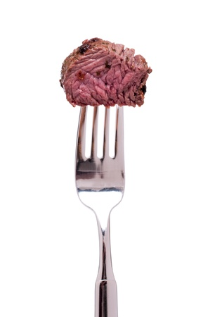 White isolated roasted ostrich meat on a fork