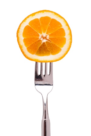 citrous: White isolated slice of orange on a fork