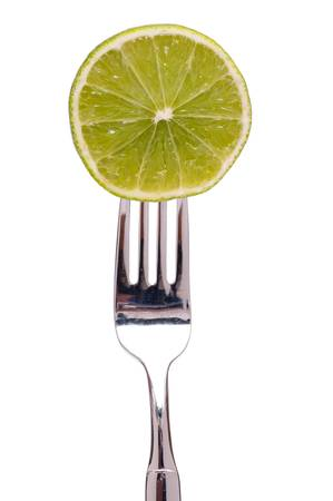 citrous: Slice of a citrous fruit lime on a fork