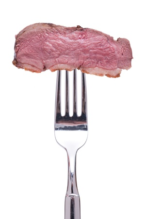 Roasted duck breast on a fork is white isolated Stock Photo