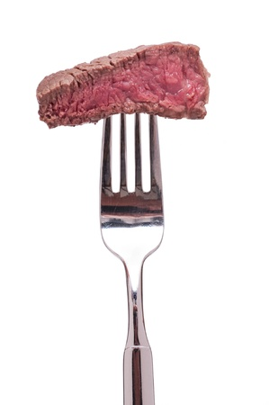 White isolated roasted rare fillet of beef on a fork