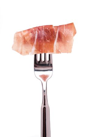 parma ham: White isolated raw parma ham on a fork Stock Photo