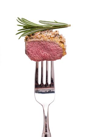 White isolated saddle of lamb with thyme on a fork Stock Photo - 13483345