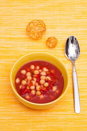 chickpeas: Soup with chickpeas and tomatoes in vertical-format Stock Photo