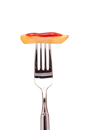 White isolated french fries with ketchup on a fork photo