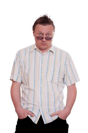 sceptical: Man with sunglasses and both hands in his pockets and a sceptical glimpse