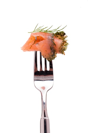 White isolated marinated salmon with dill