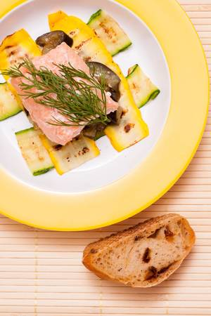 Plate with salmon filet with vegetable and ciabatta photo