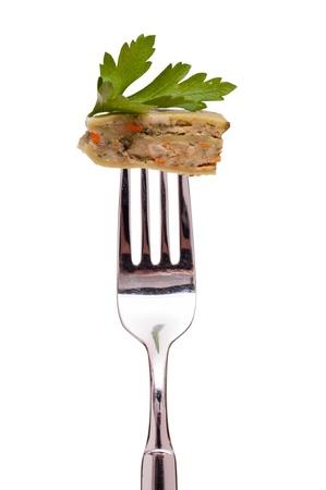White isolated vegetarian swabian pocket on a fork photo