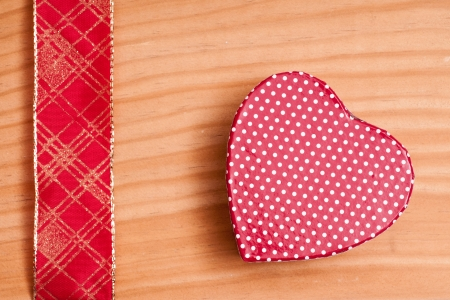Red heart and golden ribbon on a wooden board Stock Photo - 14839407