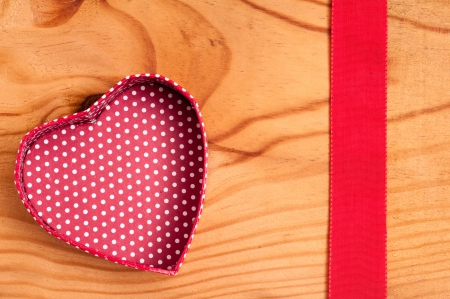 Open heart and red ribbon on a wooden board Stock Photo - 14839435