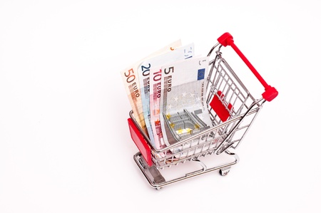 Bank notes in a cart on a white background Stock Photo - 14839356