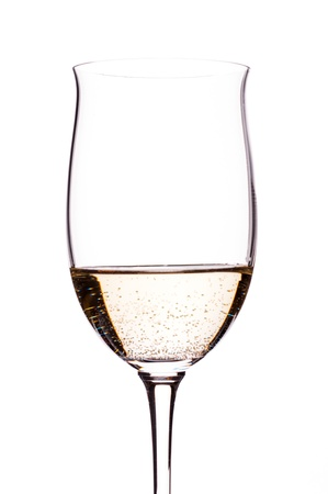 carbonated: Carbonated white wine in a wineglass