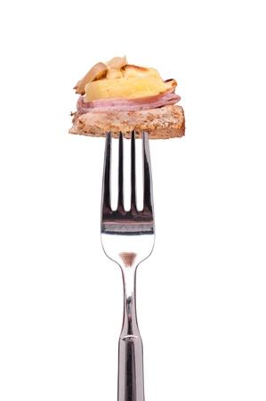 Hawai Toast with pineapple, ham and mushrooms on a fork