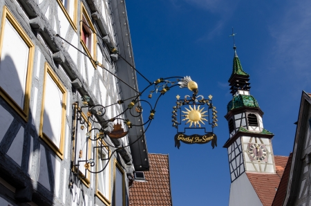 half  timbered: Half timbered inn with church steeple and blue sky