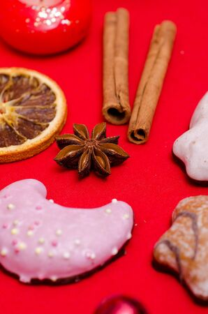 Star anise and christmas cookies on a red background Stock Photo - 15835531