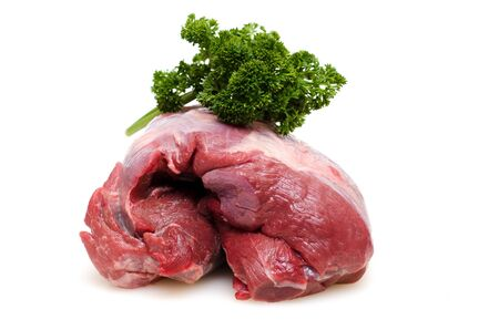 Raw roast wild boar from the shoulder with parsley Stock Photo