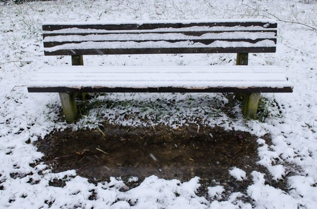 Snowy wooden bench in winter Stock Photo - 18228889