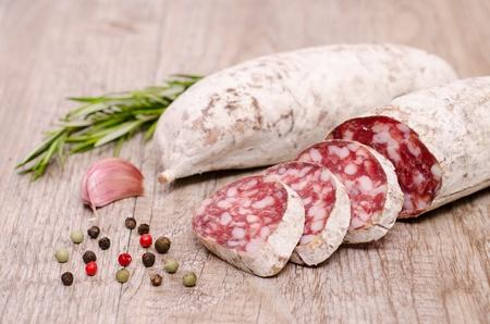 air dried salami: Italian air dried salami sausage cacciatore with condiments Stock Photo