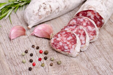 Italian Salami sausage with condiments photo