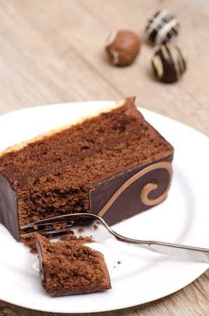 vertical format: Chocolade pudding with cake fork in vertical format