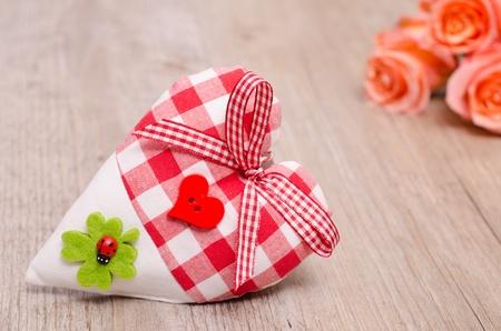Heart with shamrock, cloverleaf and orange roses Stock Photo - 19318281