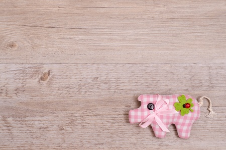 Pink pig with green shamrock as lucky charm Stock Photo - 19532523